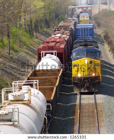Oncoming freight train passing a parked train - stock photo