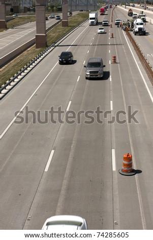 Oncoming traffic on an interstate highway with construction - stock photo