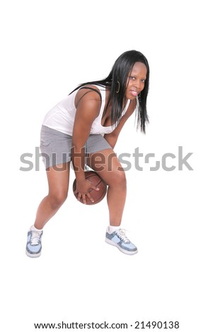 one African American woman in shorts playing basketball over white - stock photo