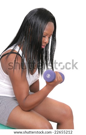 one African American woman lifting weights over white - stock photo