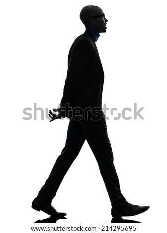 one african black man walking toothy smiling in silhouette studio on white background