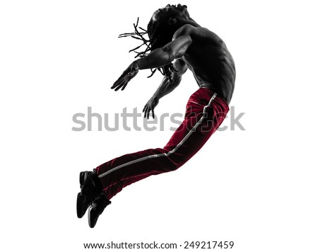 one african man exercising fitness zumba dancing in silhouette on white background - stock photo