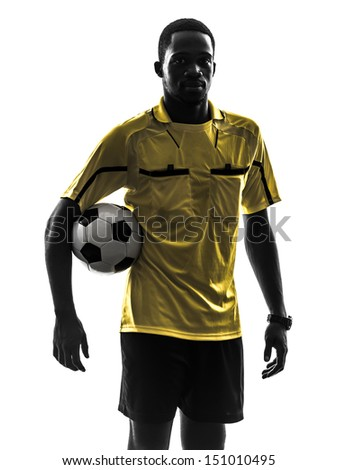 one african man referee standing holding football   in silhouette  on white background - stock photo