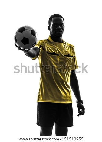 one african man referee  standing holding showing football in silhouette  on white background - stock photo