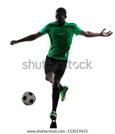 one african man soccer player green jersey in silhouette  on white background - stock photo