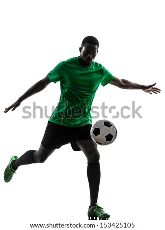 one african man soccer player green jersey kicking in silhouette  on white background - stock photo