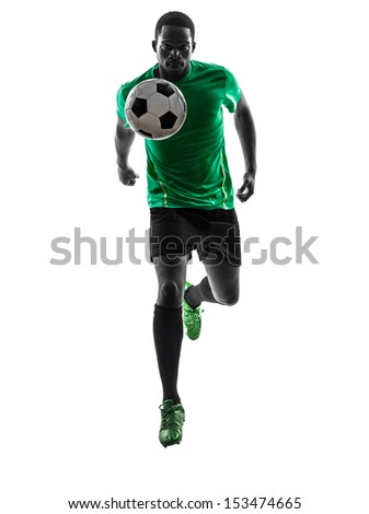 one african man soccer player green jersey running with football  in silhouette  on white background - stock photo