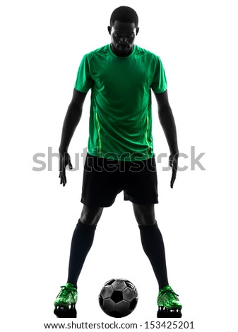 one african man soccer player green jersey standing in silhouette  on white background - stock photo