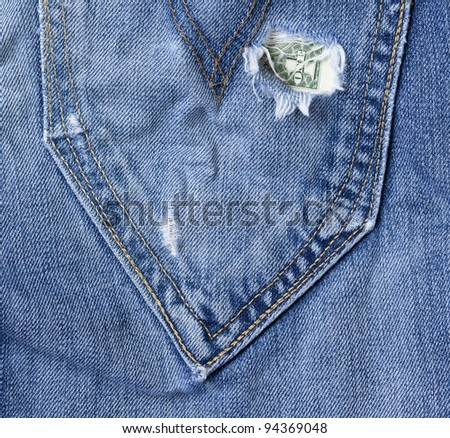 one american dollar is visible  in the hole of a jeans pocket - stock photo