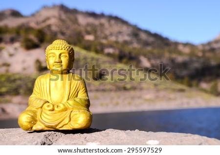 One Ancient Buddha Statue Near The Ocean - stock photo