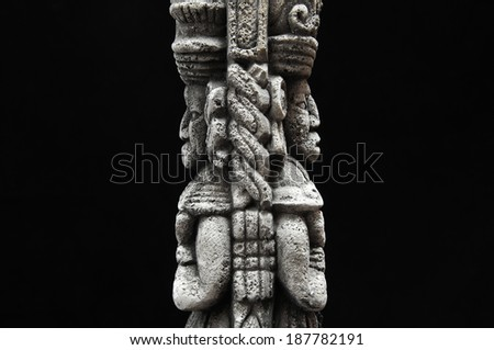 One Ancient Mayan Statue on a Black Background - stock photo