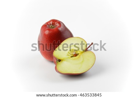 One and a half red apples on off-white background