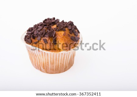 One appetizing traditional american muffin with chocolate chips homemade dessert for holiday party carbohydrates fattening bakery with many calories isolated on white background, horizontal picture - stock photo