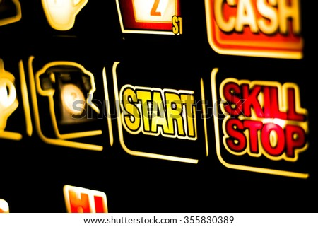 One arm bandit slot machine in casino at night photograph.