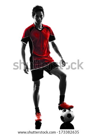 one asian soccer player young man standing  in silhouette isolated white background - stock photo