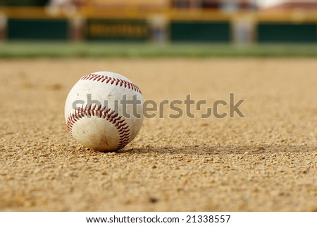 one baseball on infield of sport field - stock photo