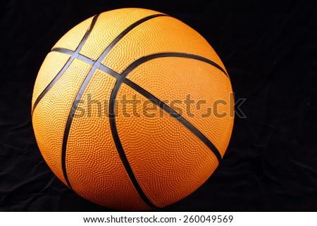 One basketball on black background  - stock photo