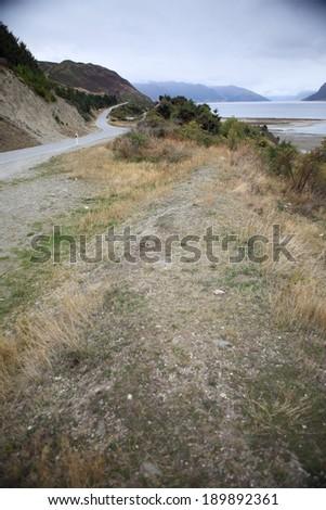 One beatiful lakeside road in New zealand. - stock photo