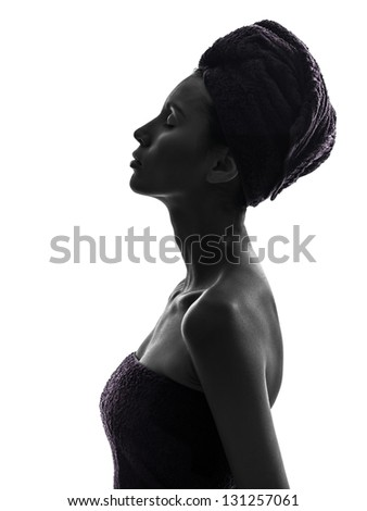 one beautiful asian young woman eyes closed portrait wrapped towel in silhouette studio isolated on white background