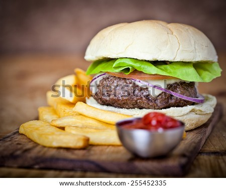 One beef burger in a bun taken in studio - stock photo