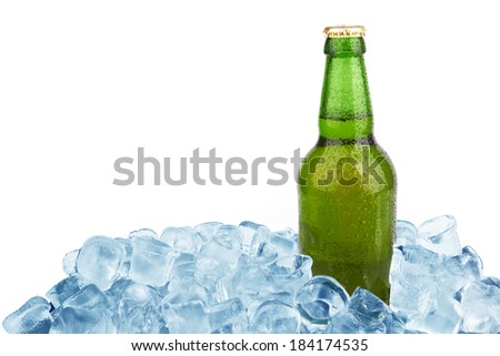 One beer bottle in ice with condensation isolated on white background