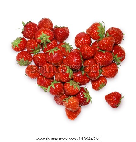 One berry is separated from the heart composed of strawberries.