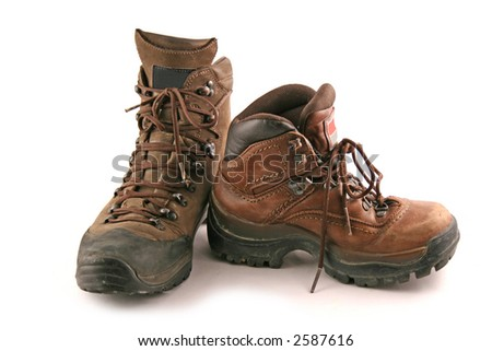One big boot next to a small one on a white background - stock photo