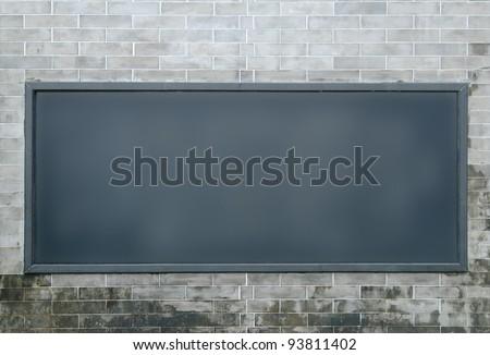 One big horizontal / landscape orientation blank billboard on Chinese brick wall - stock photo