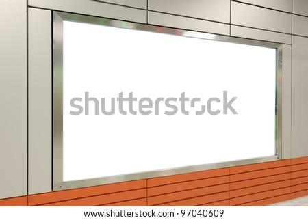 One big horizontal / landscape orientation blank billboard on modern white wall - stock photo