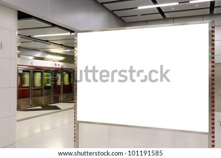 One big horizontal / landscape orientation blank billboard with train platform background - stock photo