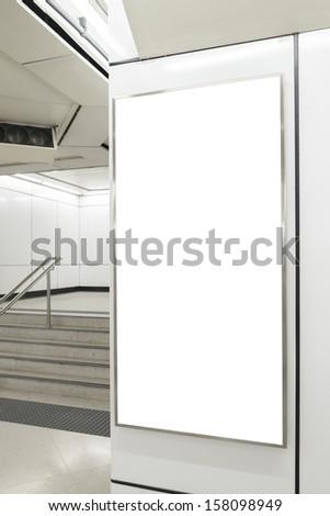 One big vertical / portrait orientation blank billboard in public transport station - stock photo