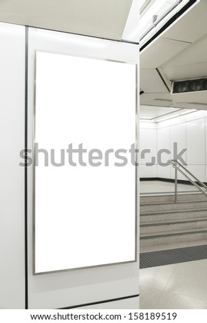 One big vertical / portrait orientation blank billboard in public transport with stair background