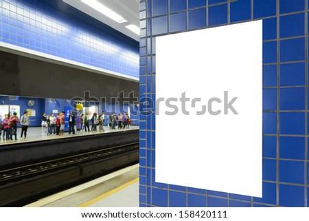 One big vertical / portrait orientation blank billboard in public transport with subway platform background - stock photo
