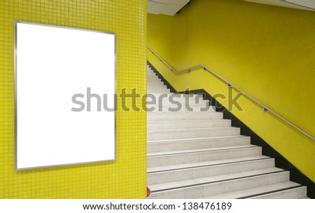 One big vertical / portrait orientation blank billboard on yellow wall with stair background - stock photo