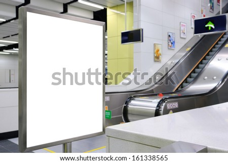 One big vertical / portrait orientation blank billboard with escalator background in public transport - stock photo