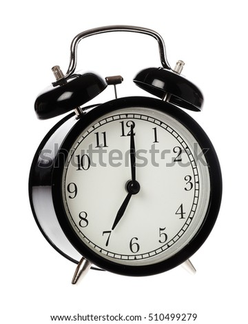 One black alarm clock display time 7 o clock on an analog clock face, isolated on white background.