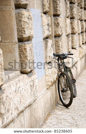 one black bicycle by building stone wall in Italy, Trieste - stock photo