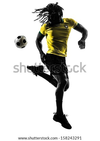 one black brazilian soccer football player man in silhouette studio  on white background - stock photo
