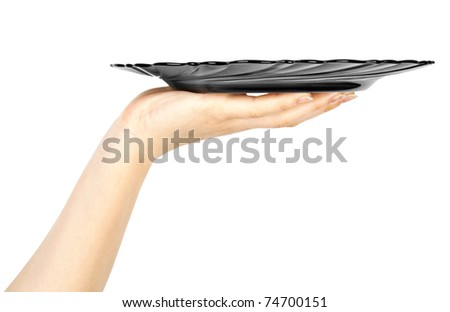 One black kitchen plate on human hand on white background - stock photo