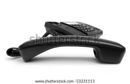 One black phone isolated on white background - stock photo