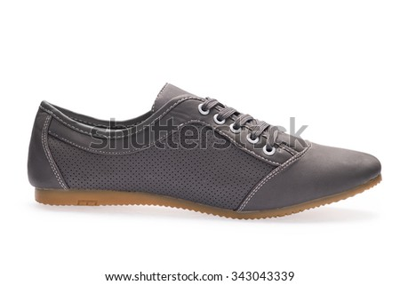 One black sports sneaker with shoelace on a white background - stock photo