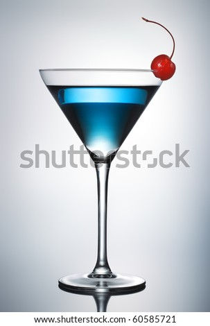 One blue cocktail martini with cherry (pen clip path included) - stock photo