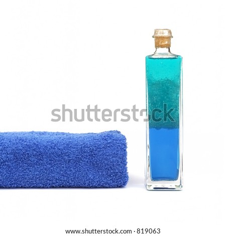one bottle of bath oil and a towel - stock photo