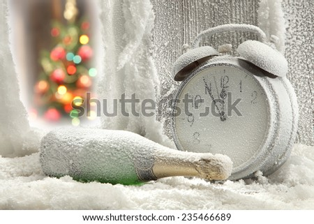 one bottle of champagne and clock  - stock photo