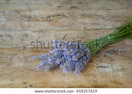 One bouquet of lavender on a old wooden background