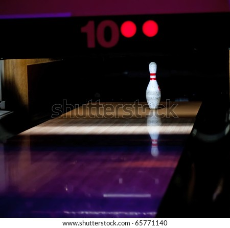 One bowl left in bowling lane - stock photo
