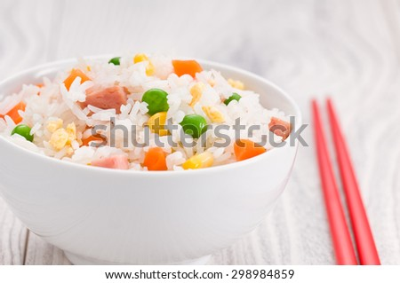 One Bowl of Fried Rice over a bright surface - stock photo