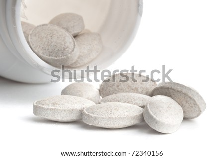 One box of grey pills over white background - stock photo