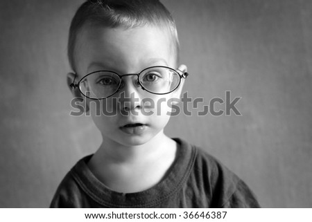 one boy with glasses looking at camera - stock photo