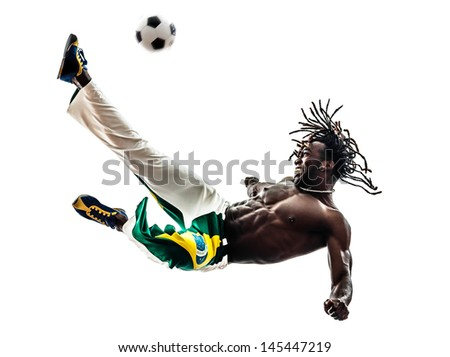 one brazilian  black man soccer player  kicking football on white background - stock photo